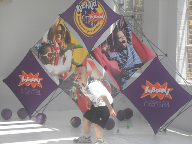 cj in front of kaboom sign
