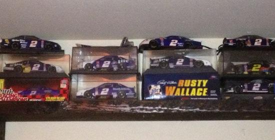 shelf of diecast cars