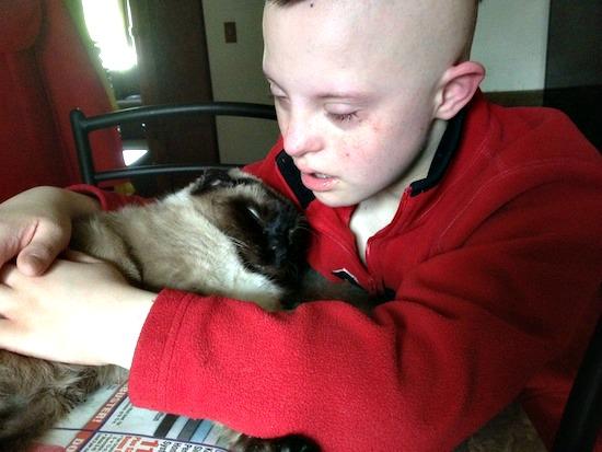 CJ sad with cat