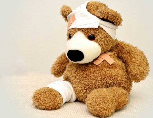 injured stuffed bear