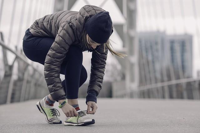 woman tying sneakers